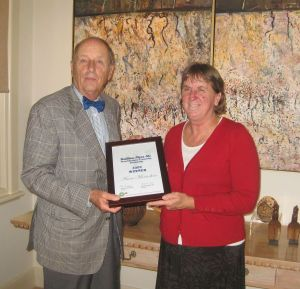 Mr Myer and me, with a framed certificate of the award.